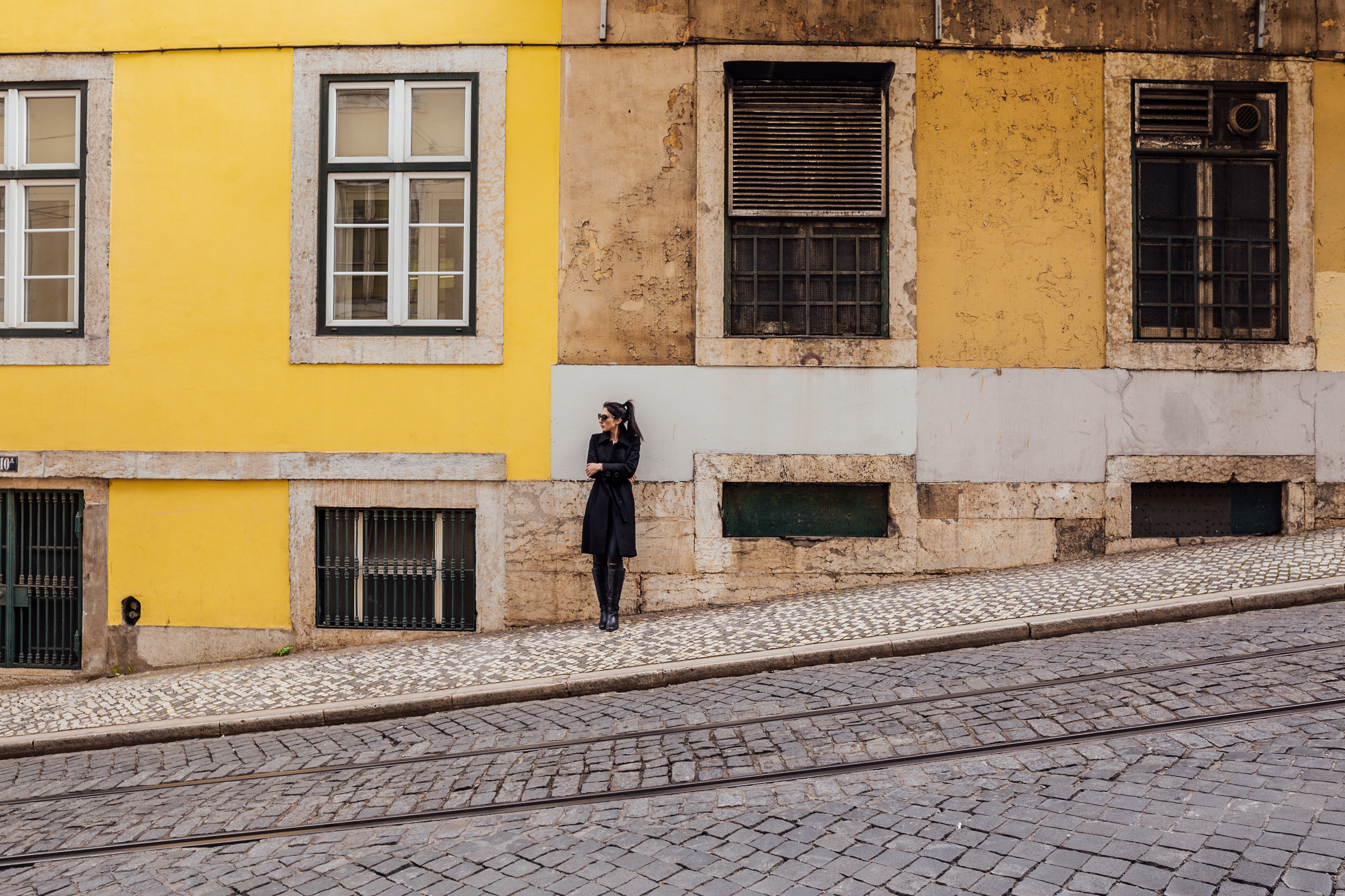 woman standing against building during daytime