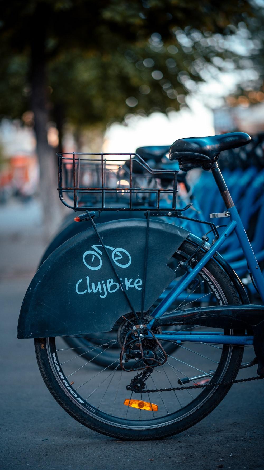 blue and black ClujBike bicycle