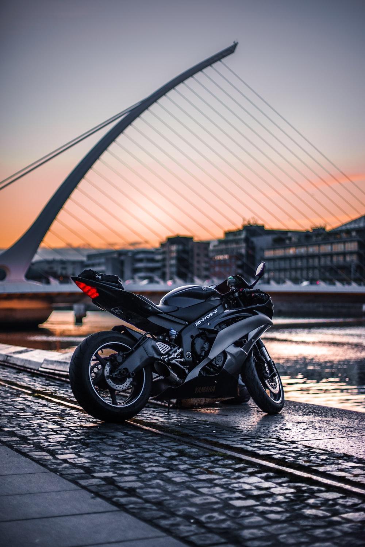 black sports bike at daytime