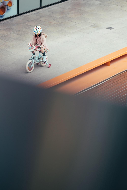 girl riding bike on hallway