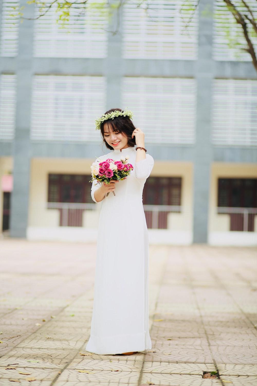 woman holding pink flower bouquet