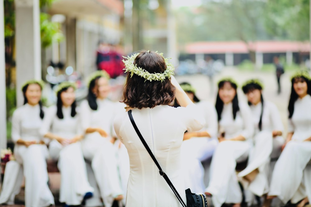 group of woman wearing white dresses
