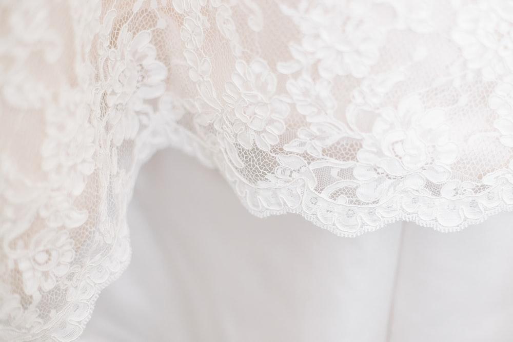 white floral textile