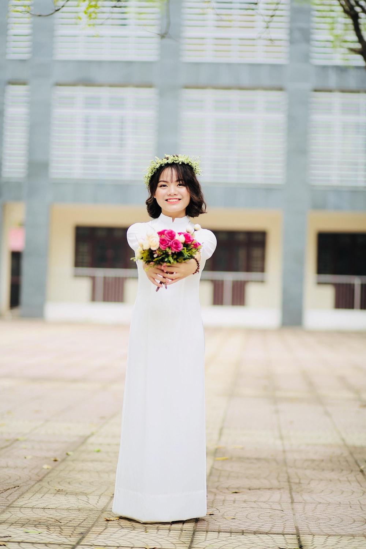 woman holding bouquet of petal flower