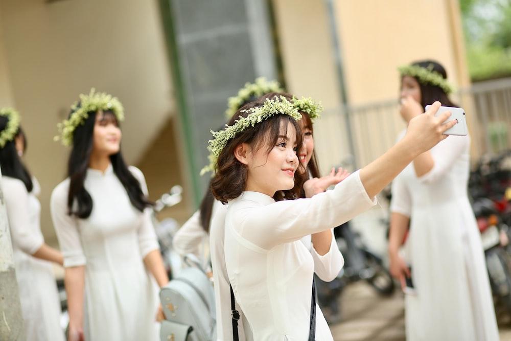 woman wearing floral headgear