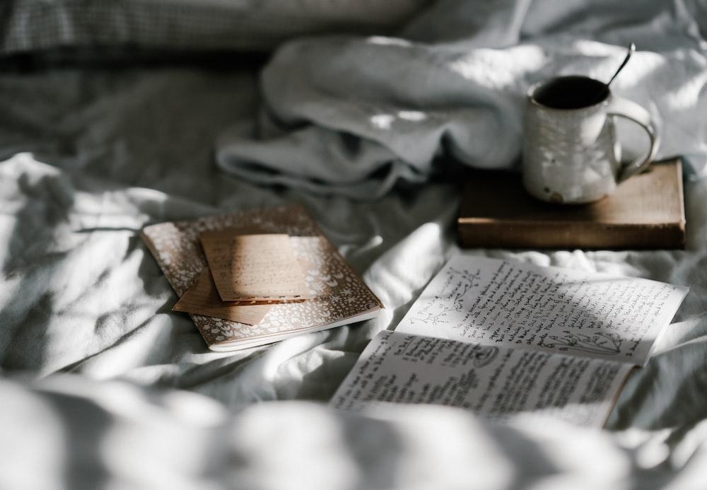 white mug beside white paper