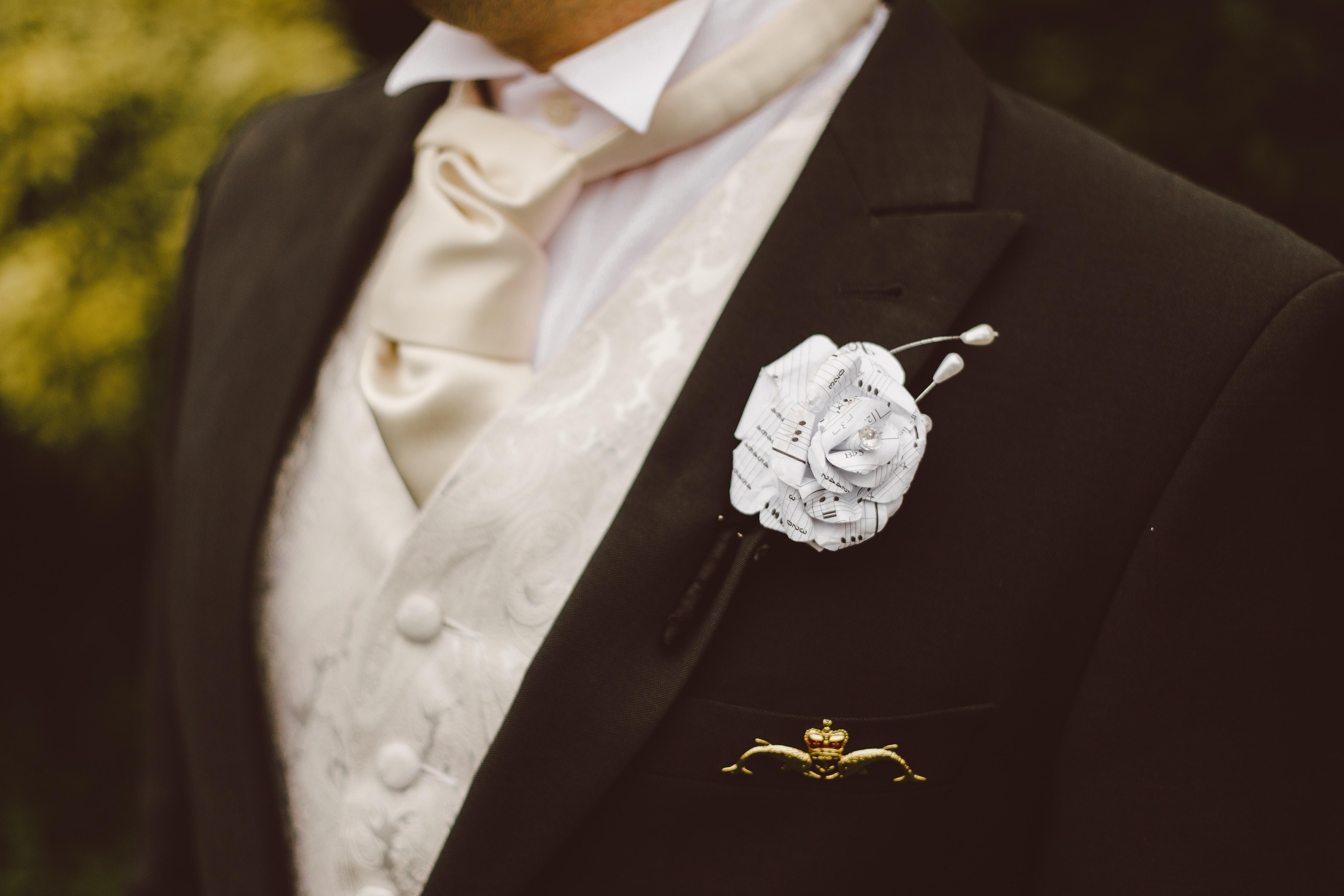 person wearing peaked lapel suit jacket