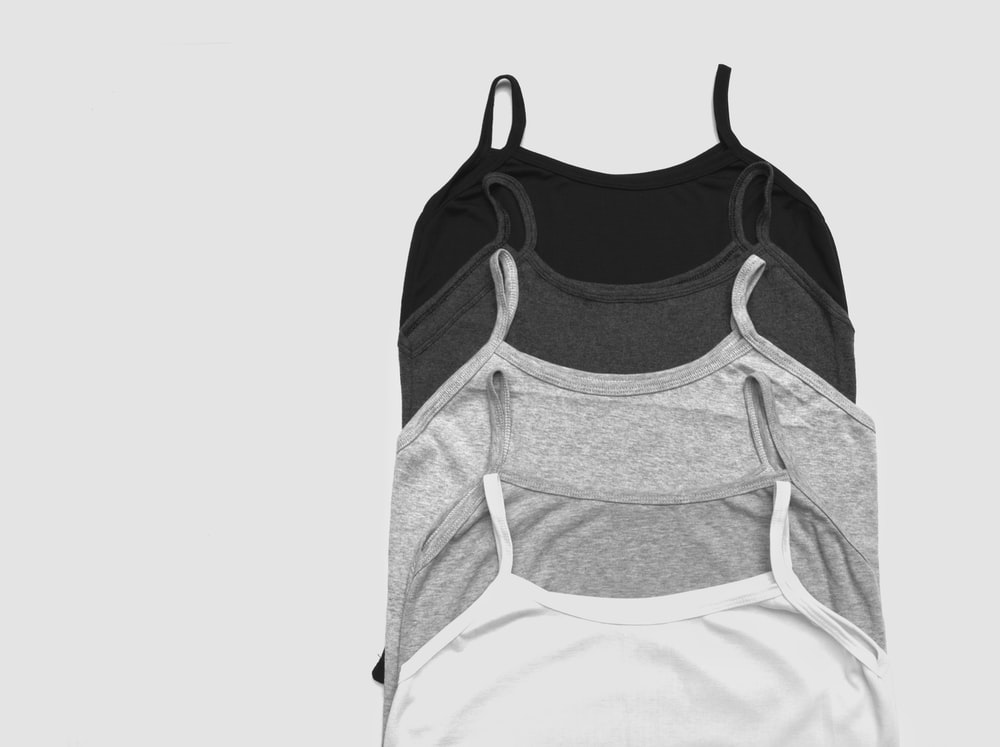 grayscale photos of five camisoles