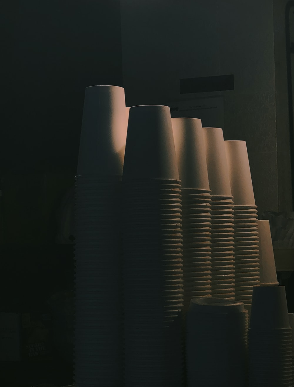 pile of white plastic cups