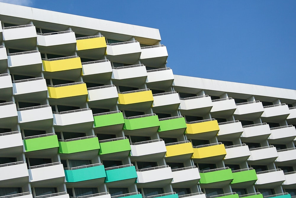 white, green, and yellow painted building