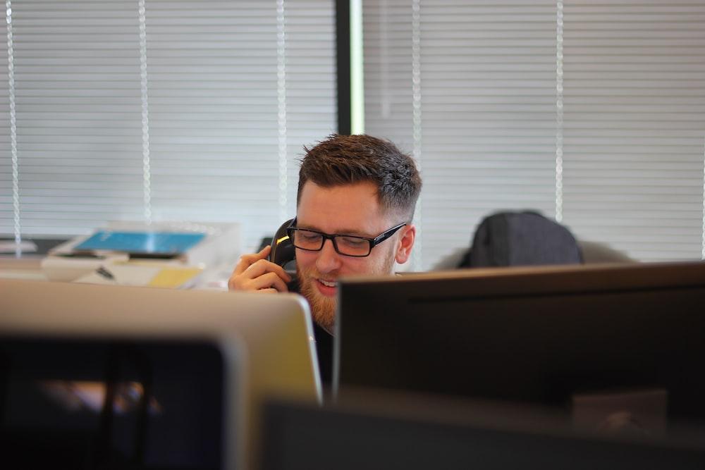 man using IP phone inside room
