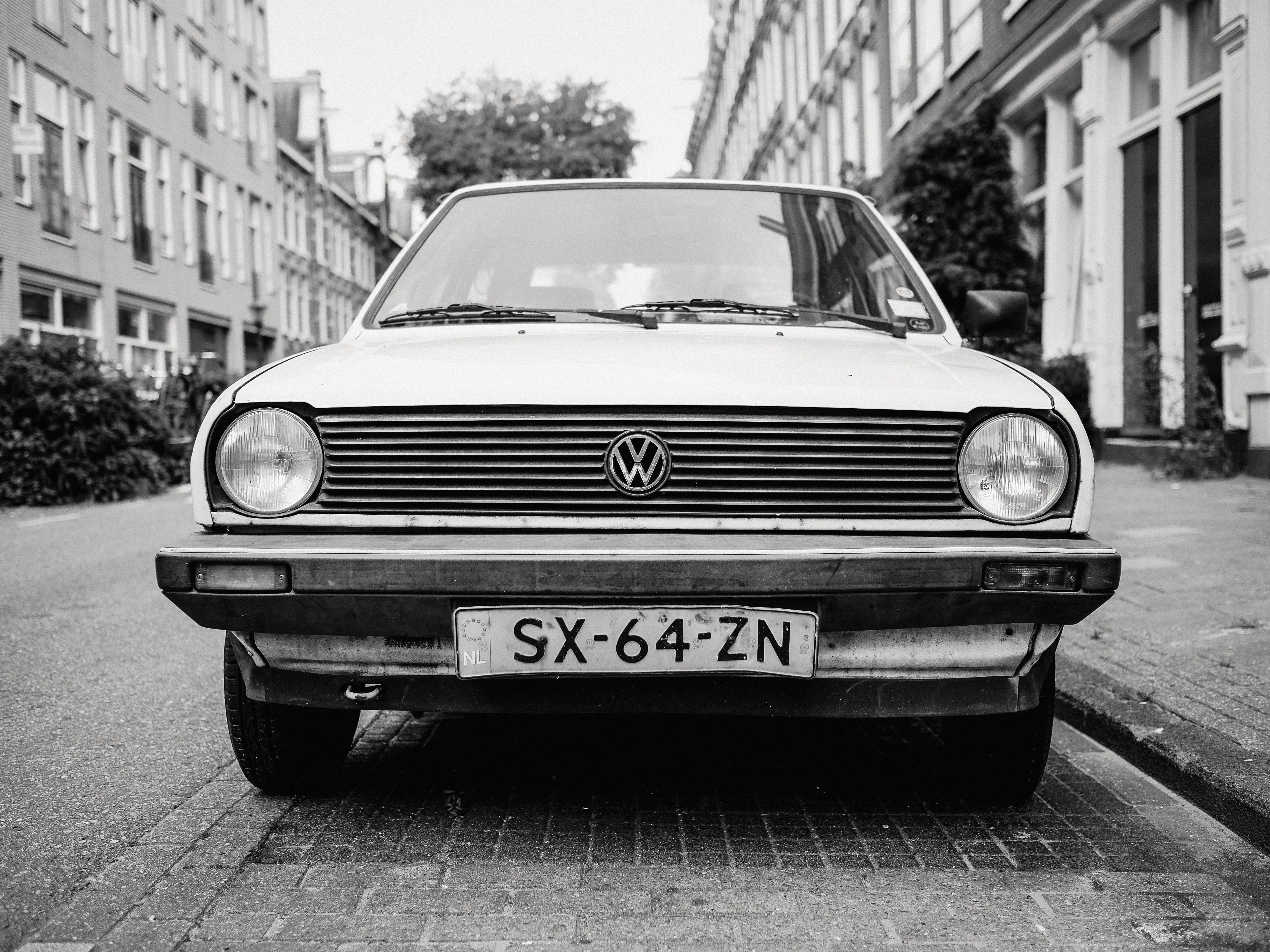 greyscale photo of white Volkswagen car