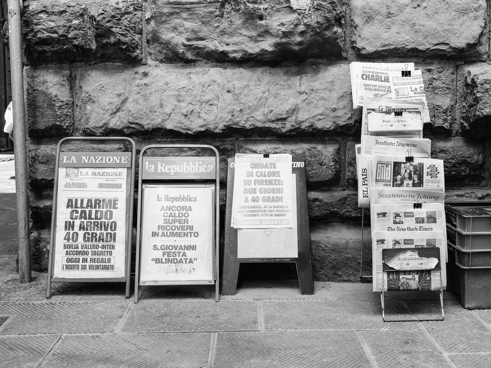 assorted signages in grayscale photography