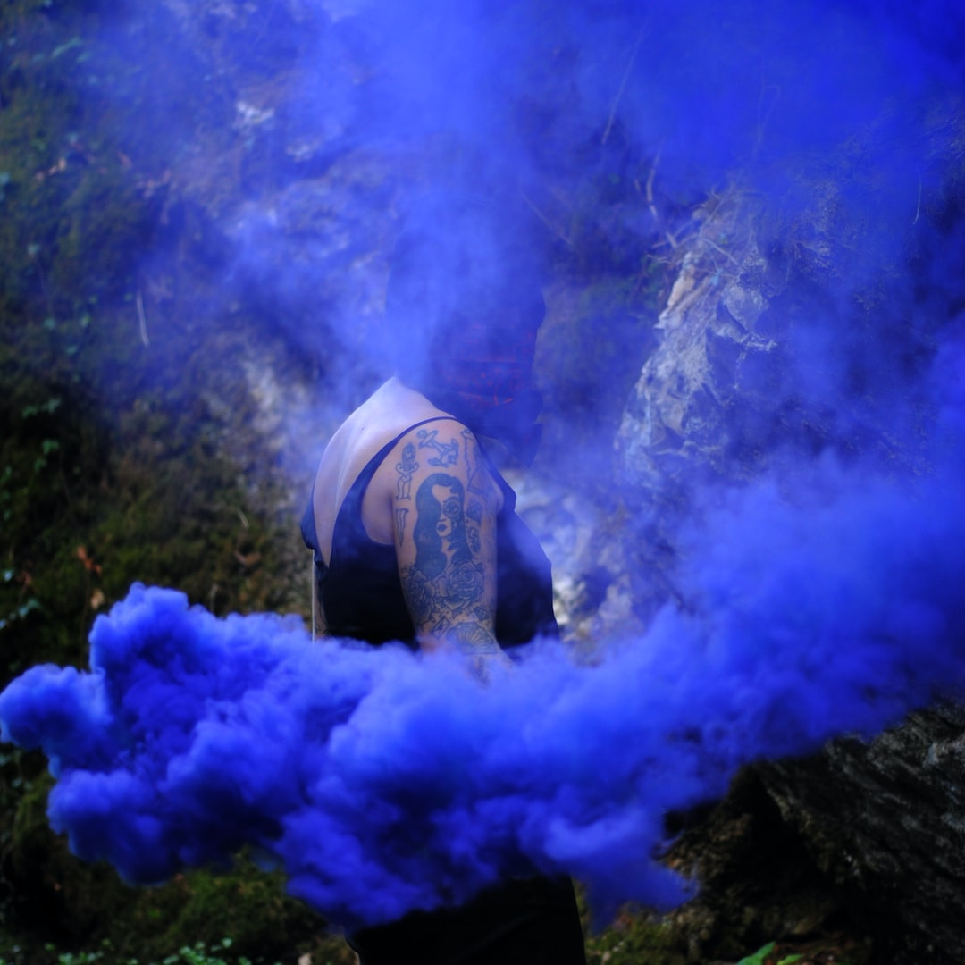 in the woods, with smoke grenades.