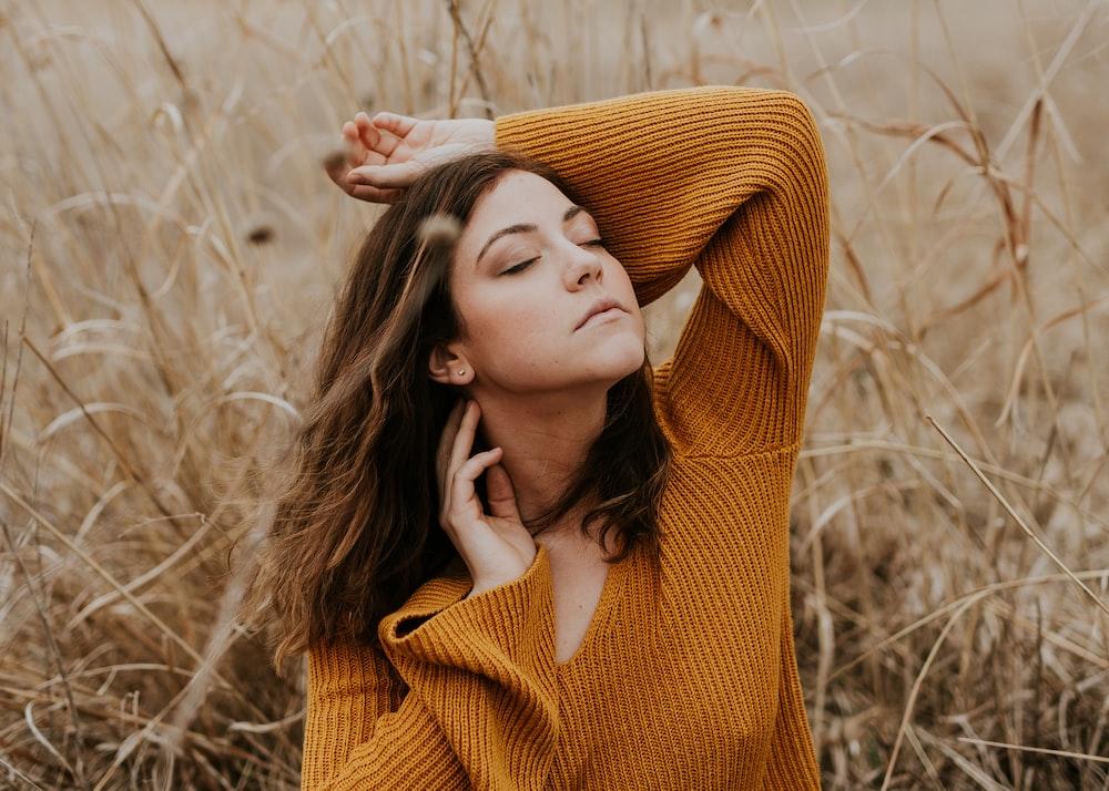 women's orange sweater feeling breeze