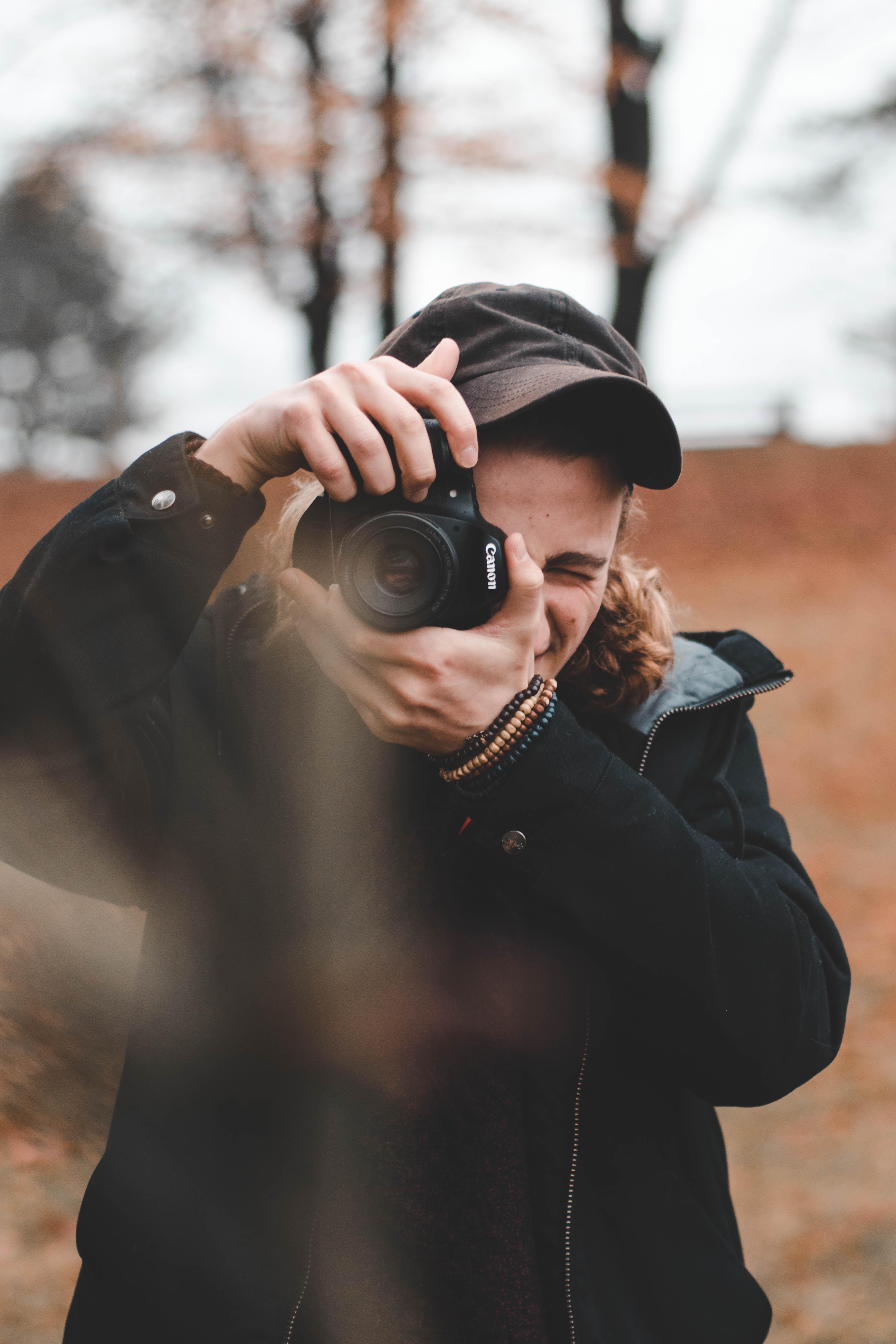 man taking photo using DSLR camera