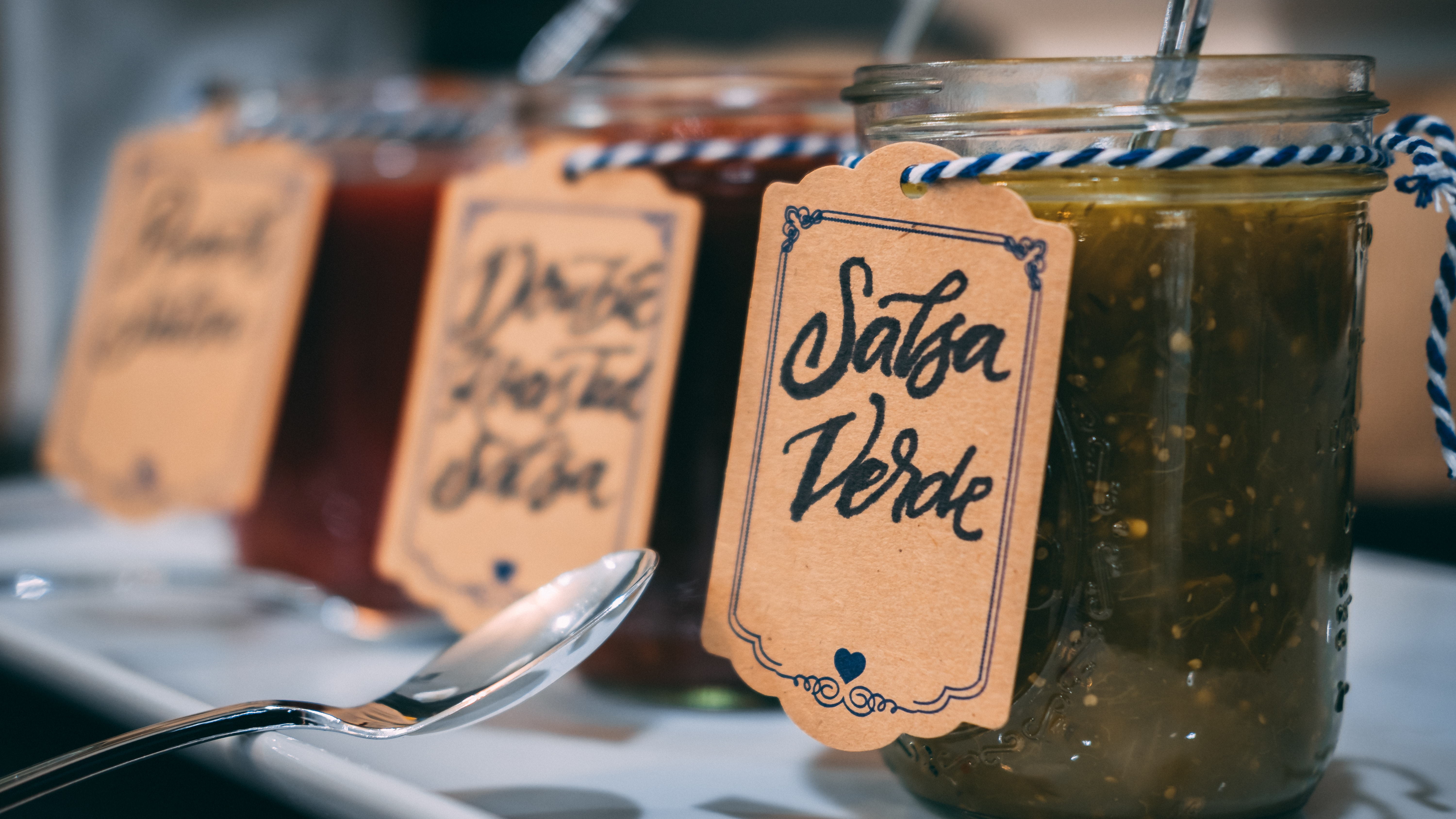 clear glass jar with Salsa Verde tag