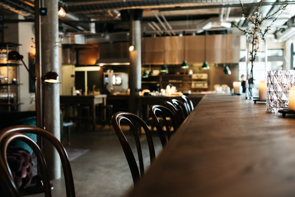empty brown wooden restaurant table with chairs