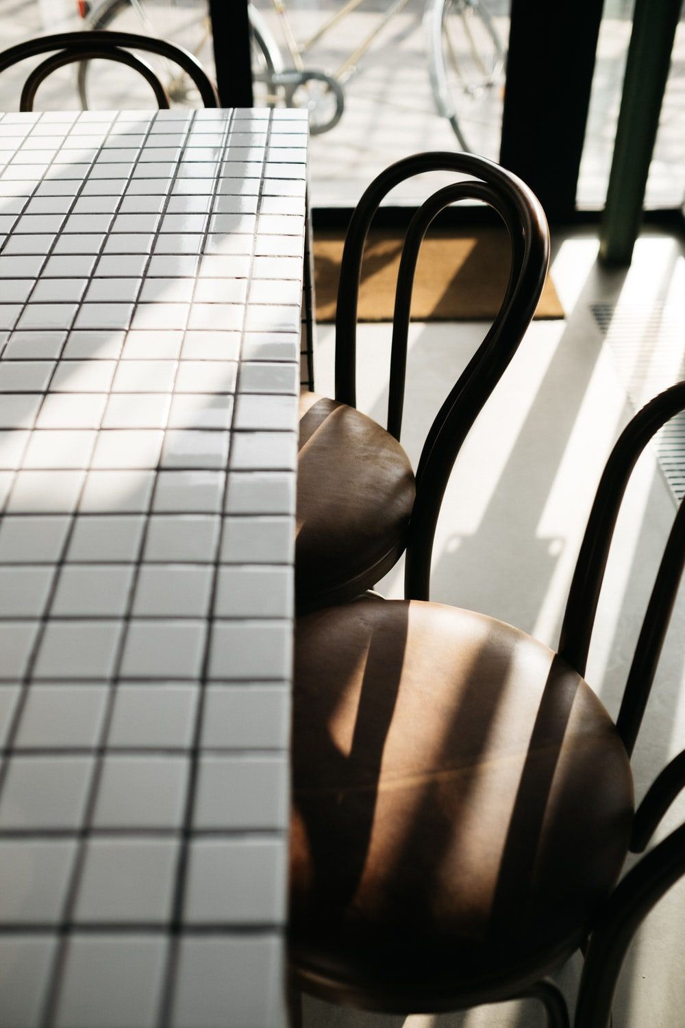 closeup photo of rectangular white table and two chairs