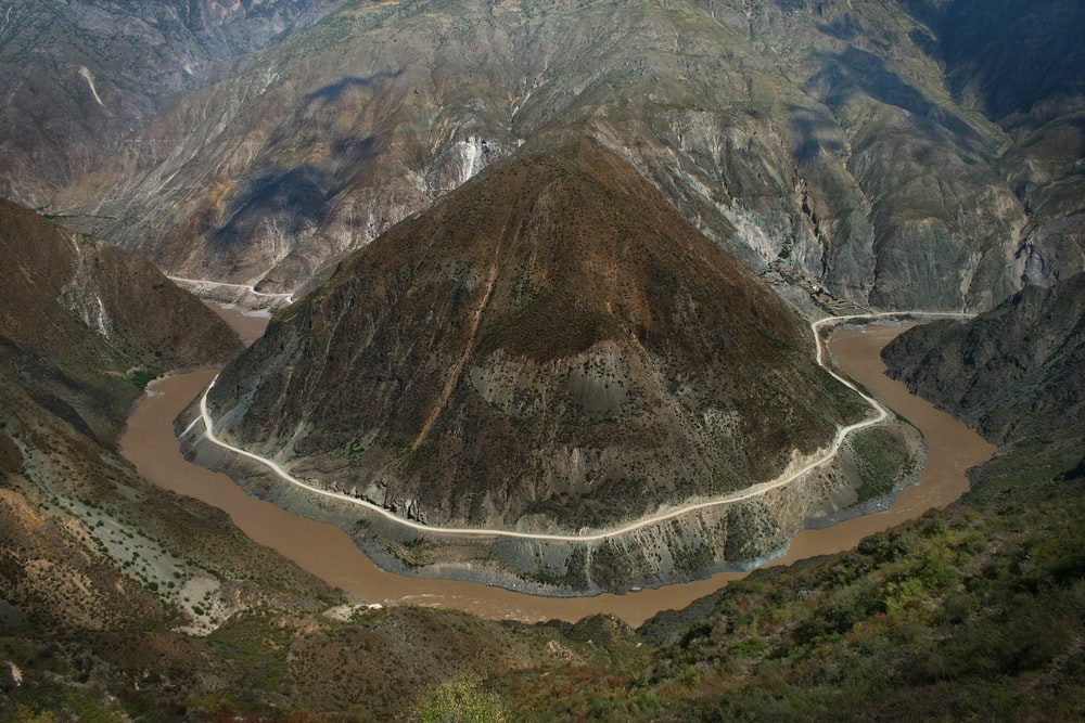 aerial of mountain between body of water