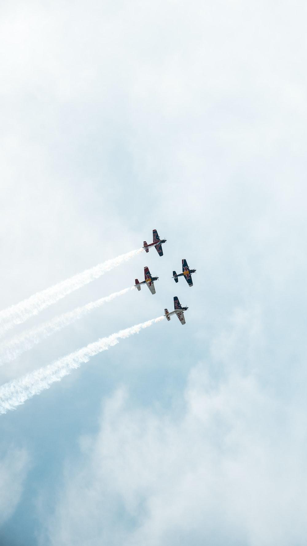 five jet planes under cloudy sky