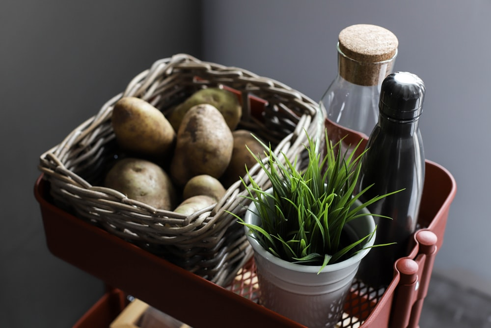 basket of potato with two bottles