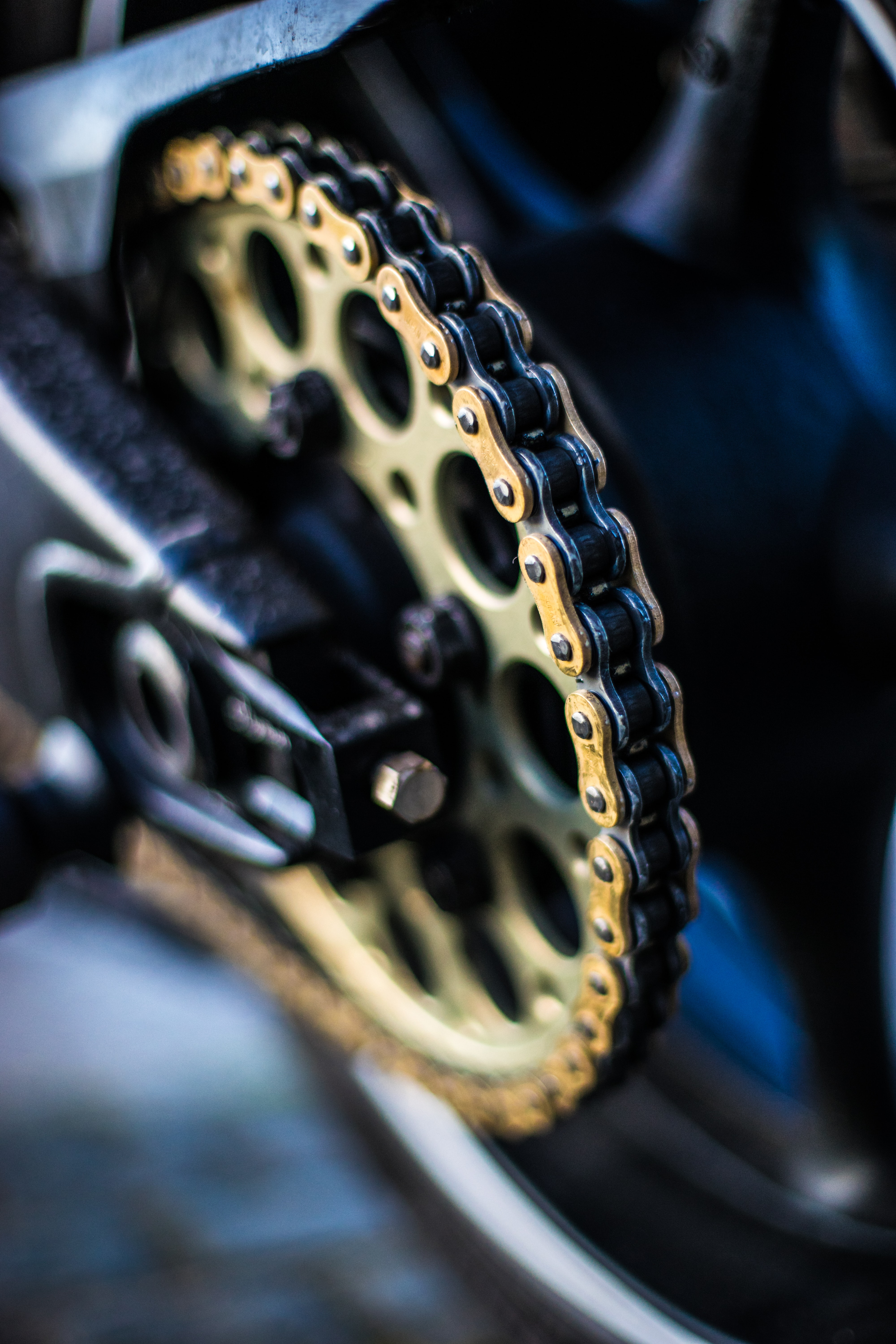 selective focus photography of gold sprocket