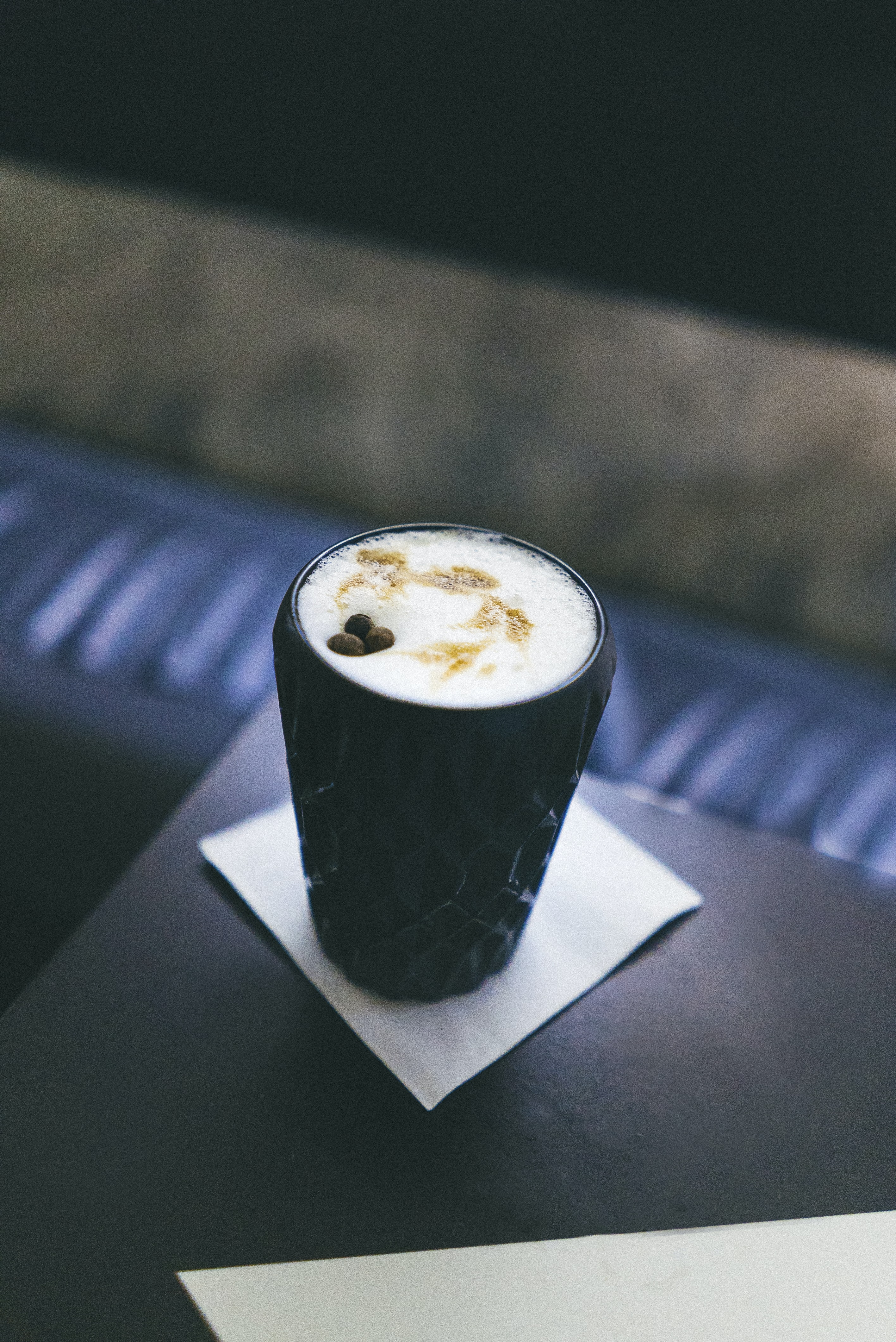 black ceramic cup with white latter art