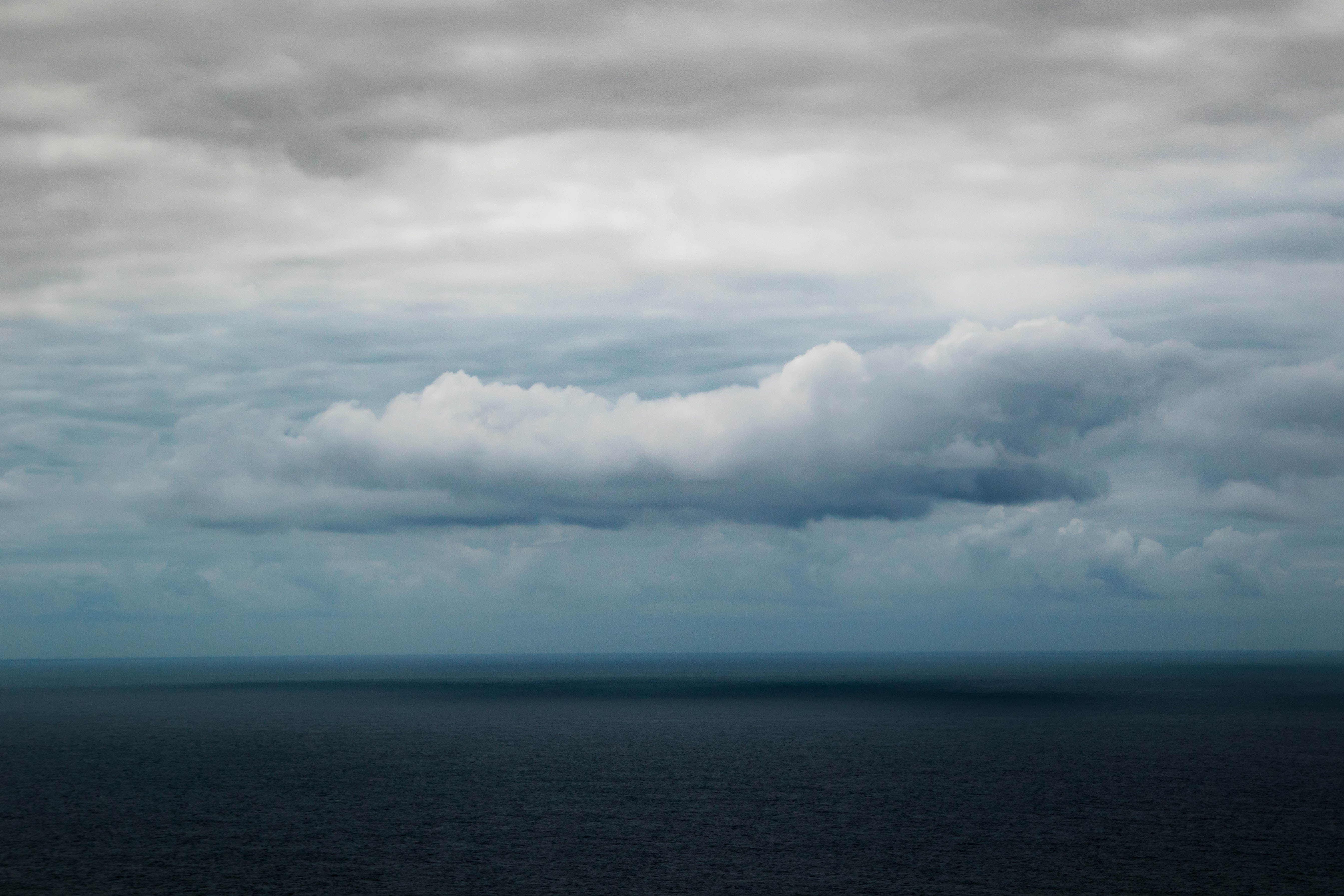 body of water and clouds during daytime