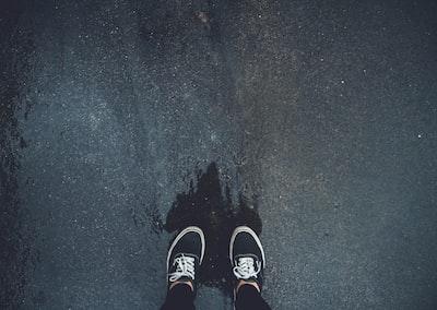 person wearing pair of black sneakers