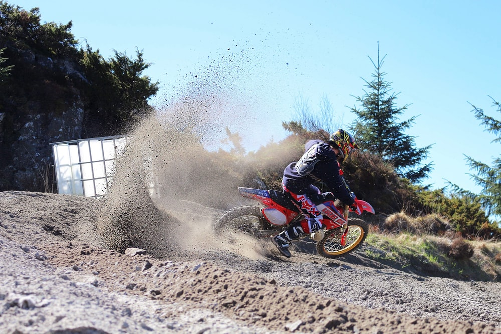man riding on motocross dirt bike
