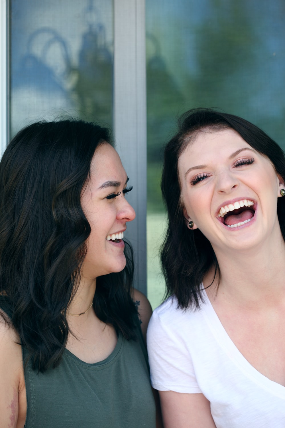 two woman laughing