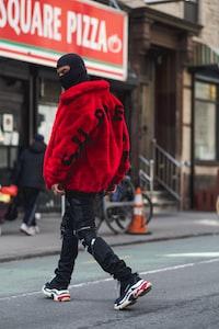 man walking on streets during daytime