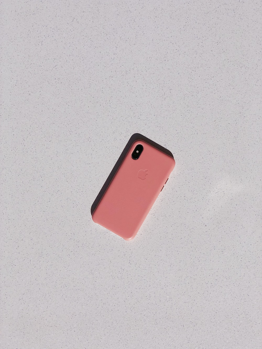 pink Android smartphone close-up photography