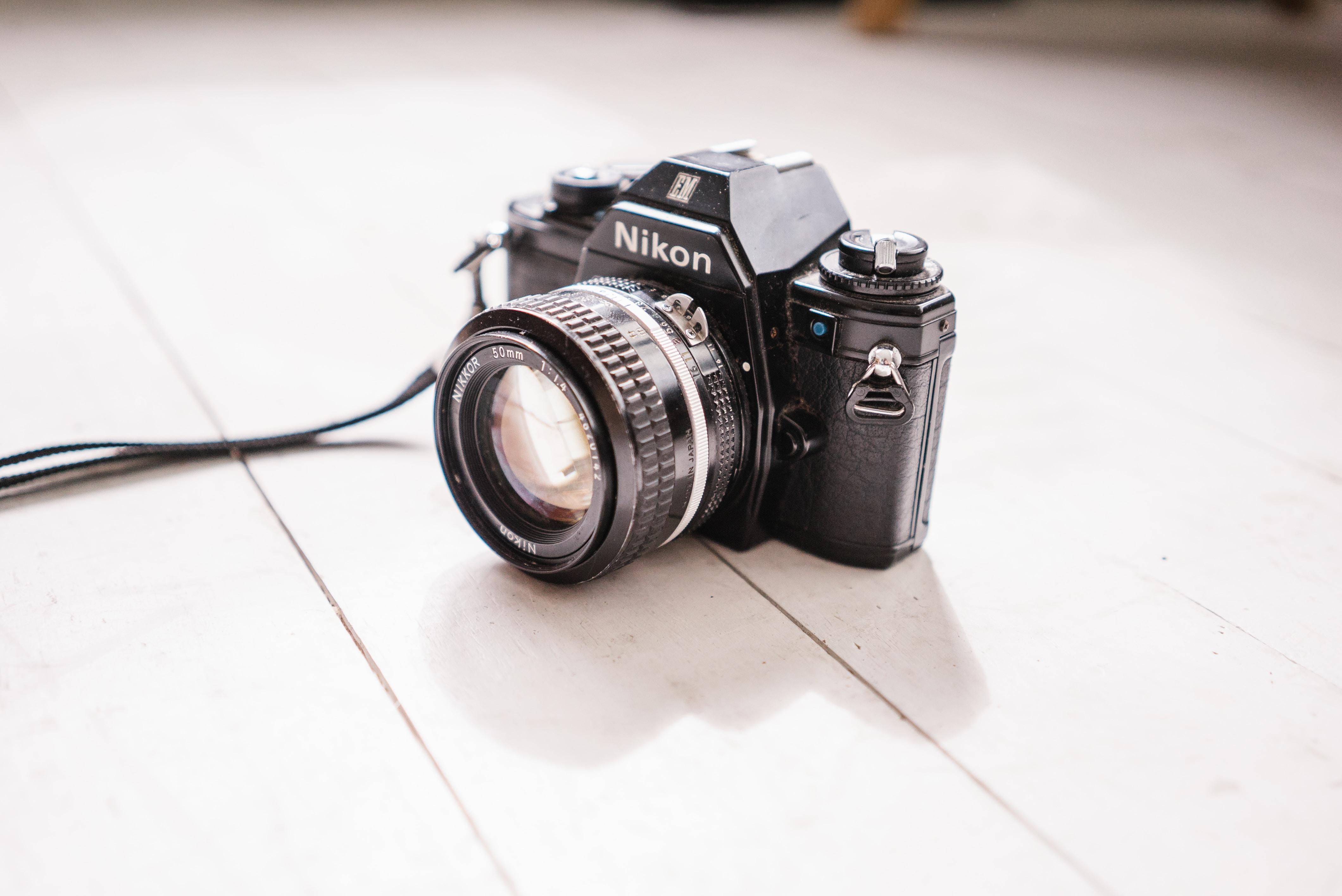 black Nikon SLR camera