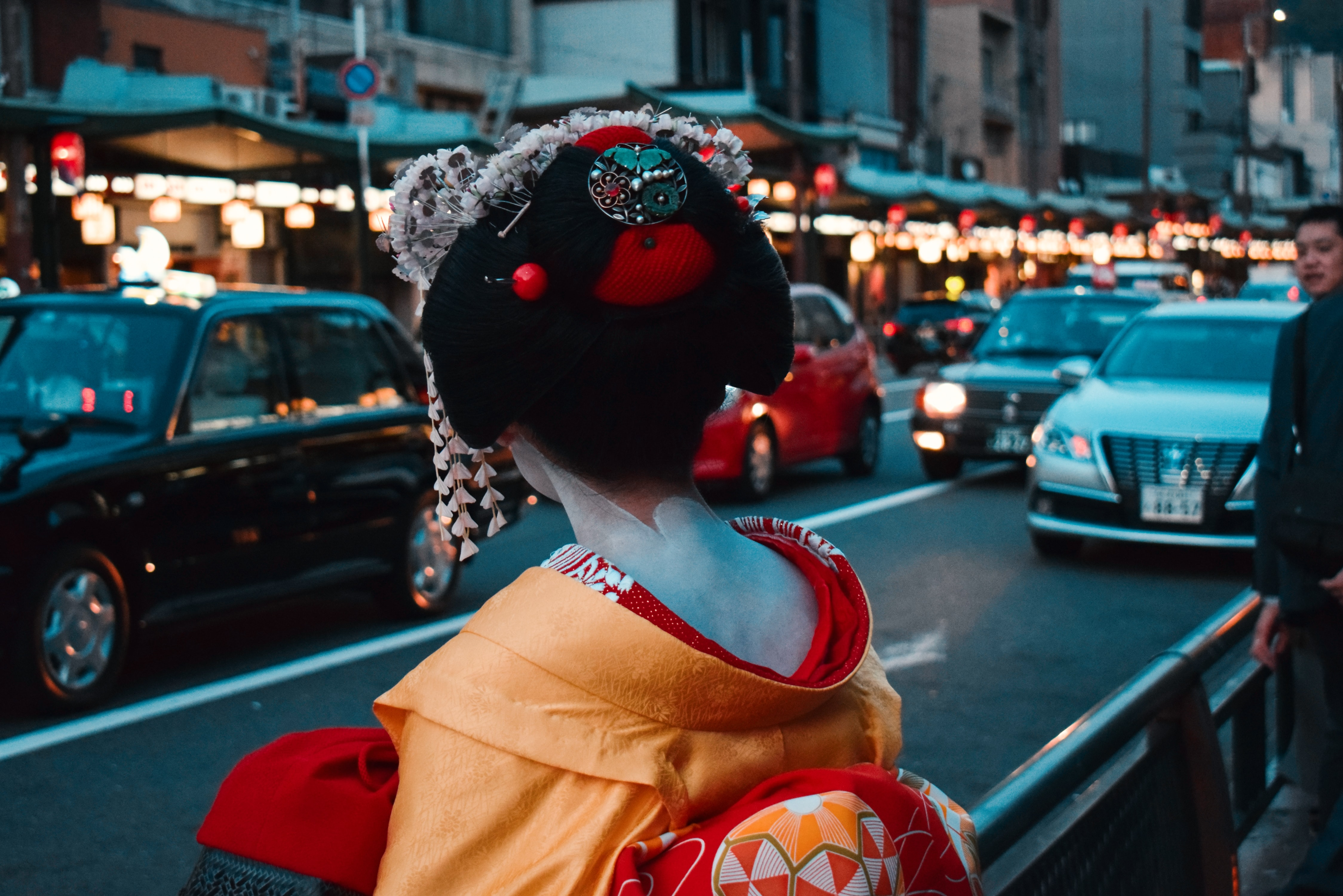 selective focus photography of geisha standing on street while facing on car
