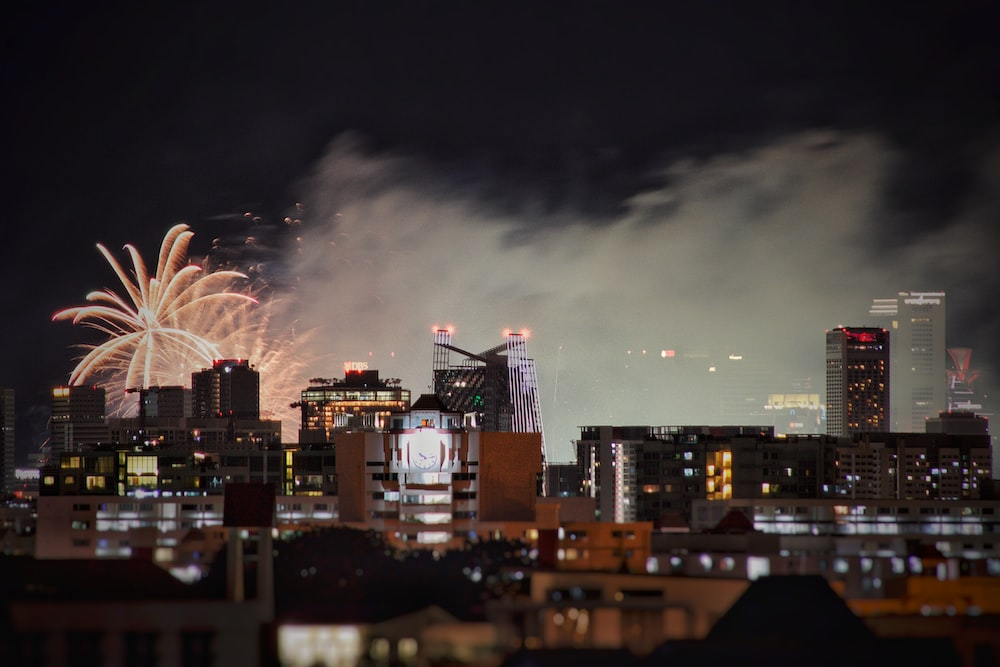 fireworks display near city buildings during night time