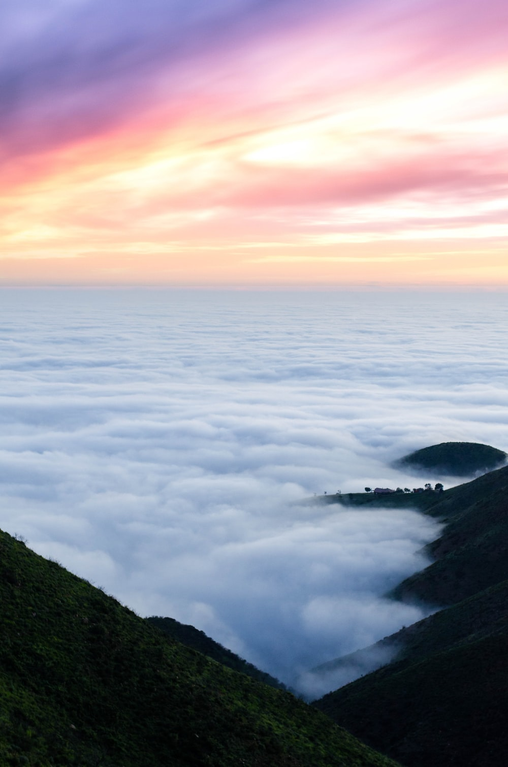 bed of sea clouds on mountain