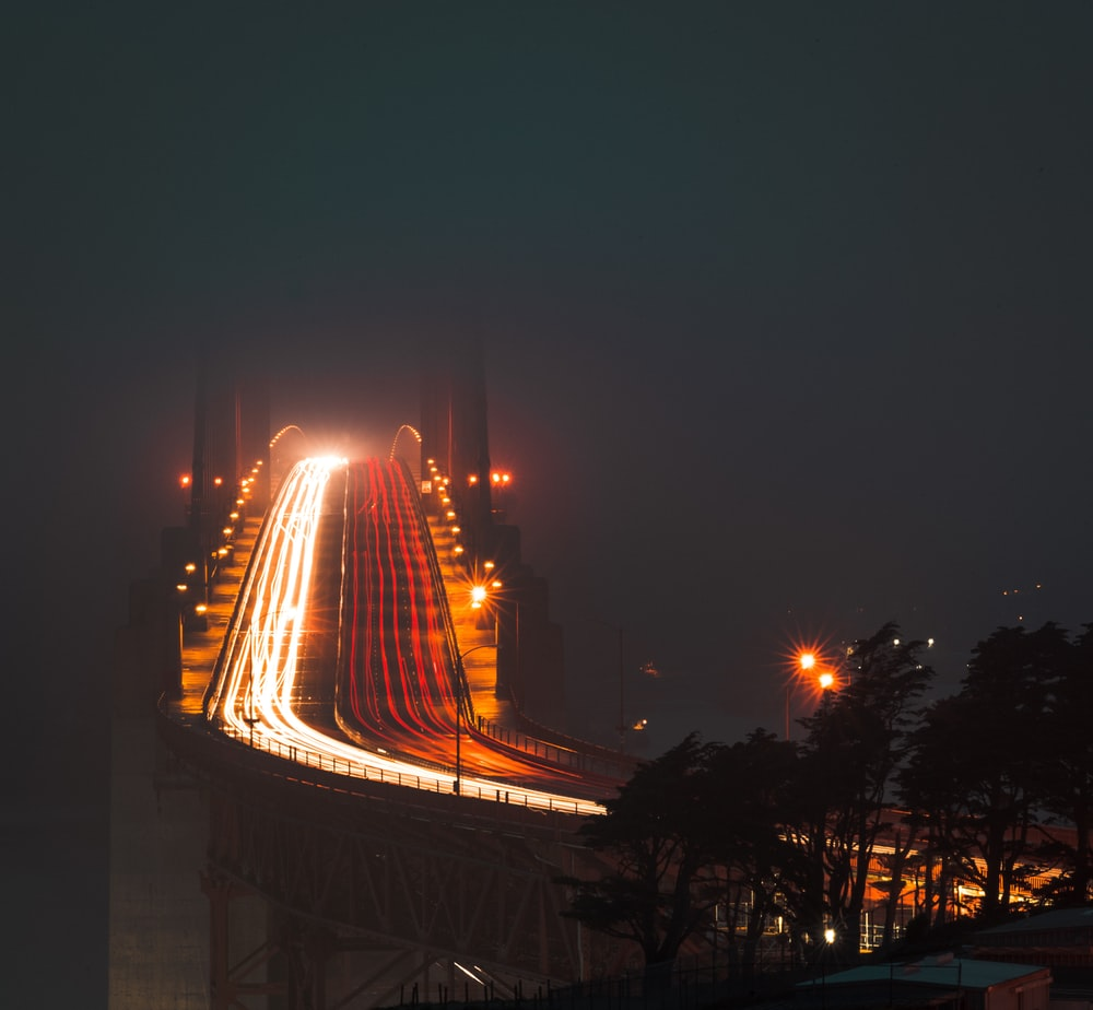 time lapse photography of cars on bridge