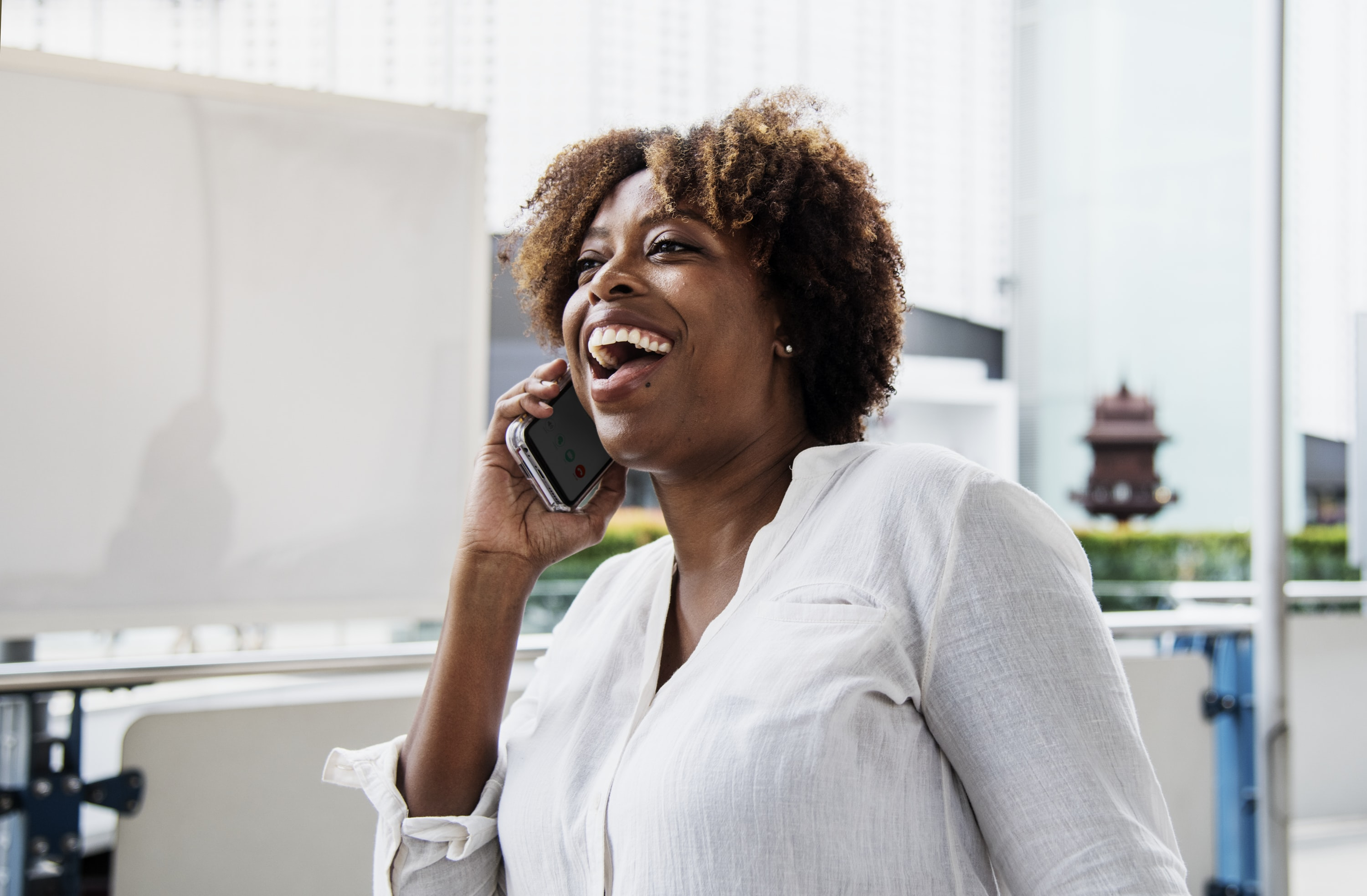 woman laughing while on call