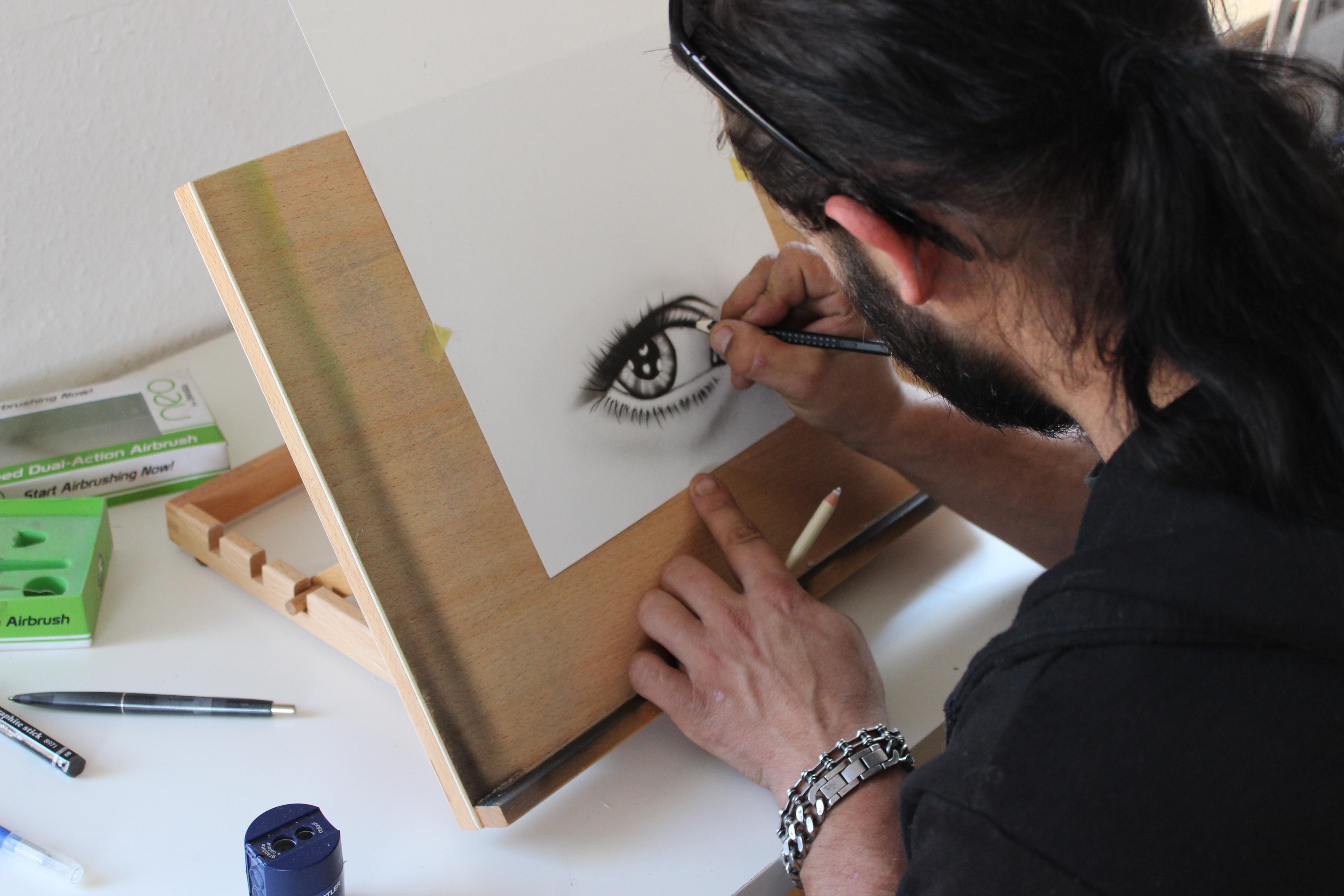 Man painting human eye