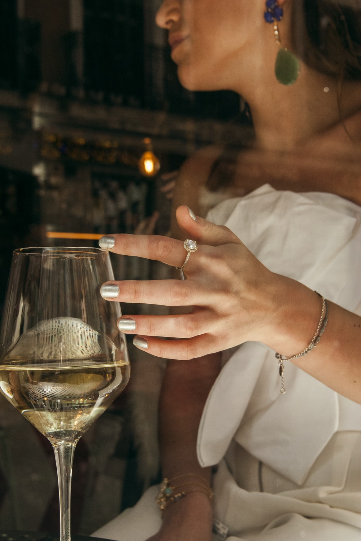 woman sitting holding wine glass