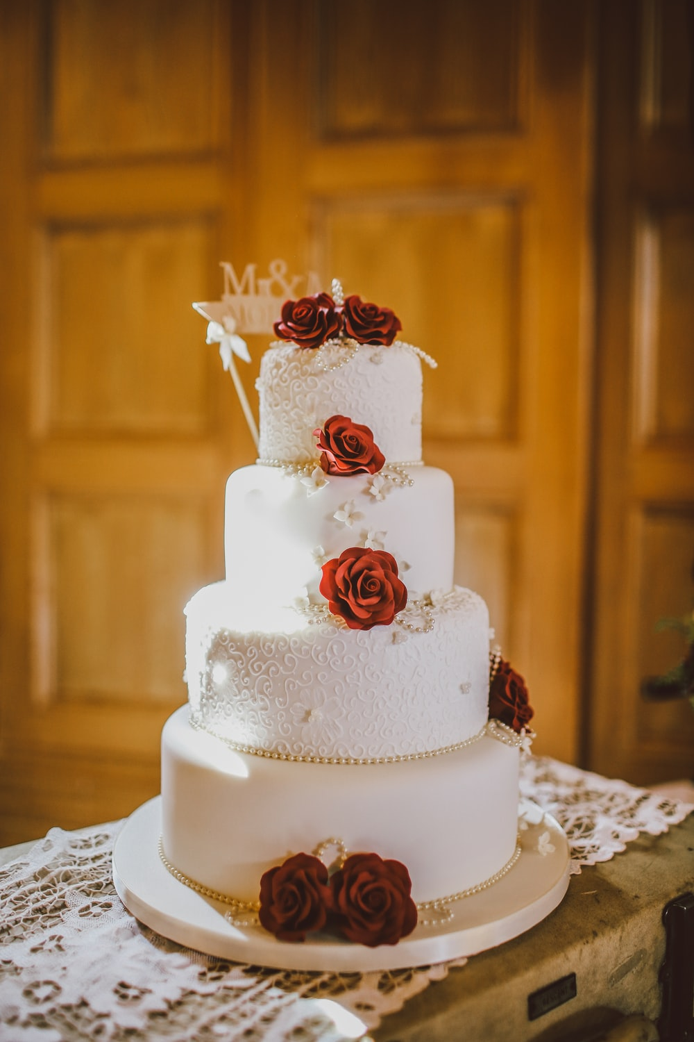 round white floral 4-tiered fondant cake
