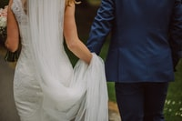 wedding couple holding hands while walking
