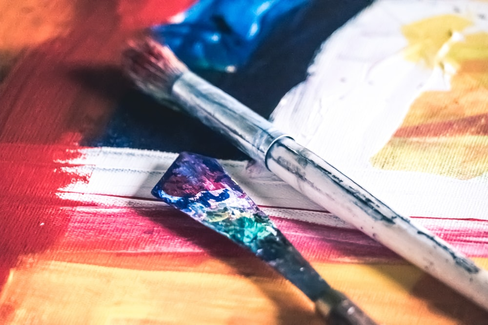 blue and silver paint brush