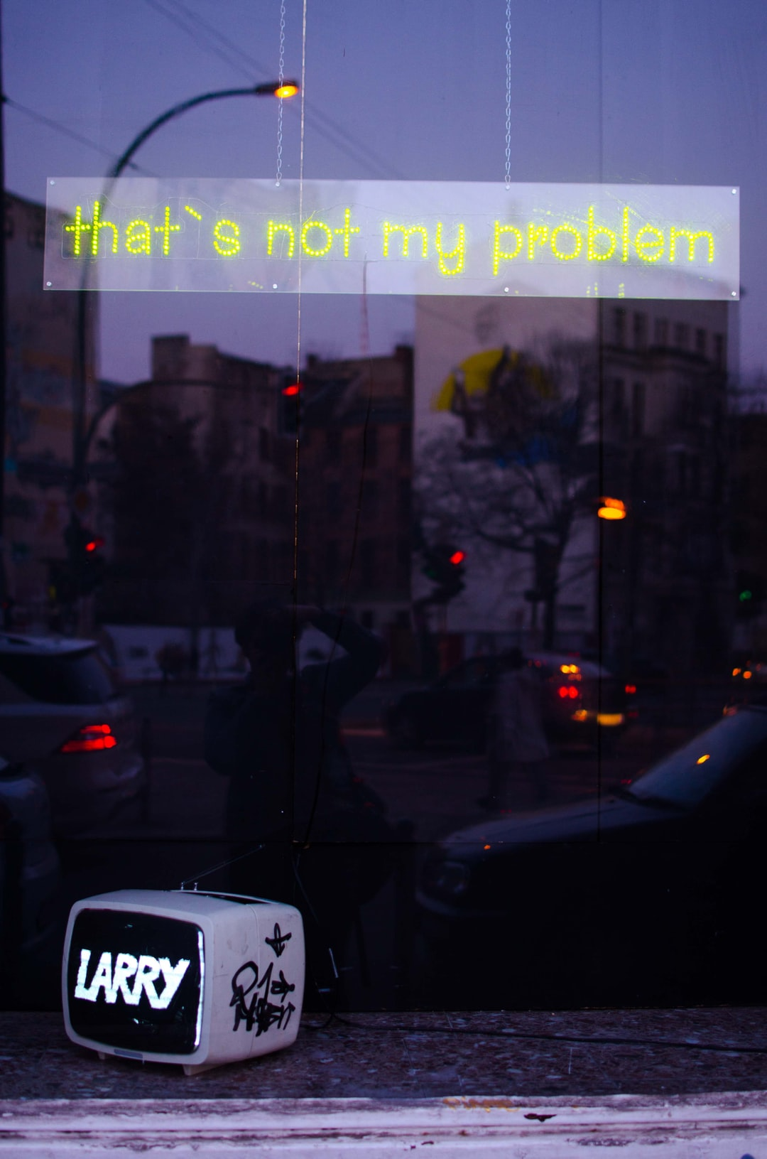 Taken during a lazy walk on a solo trip to Berlin. What captured me is the purple glow and yellow neon sign.