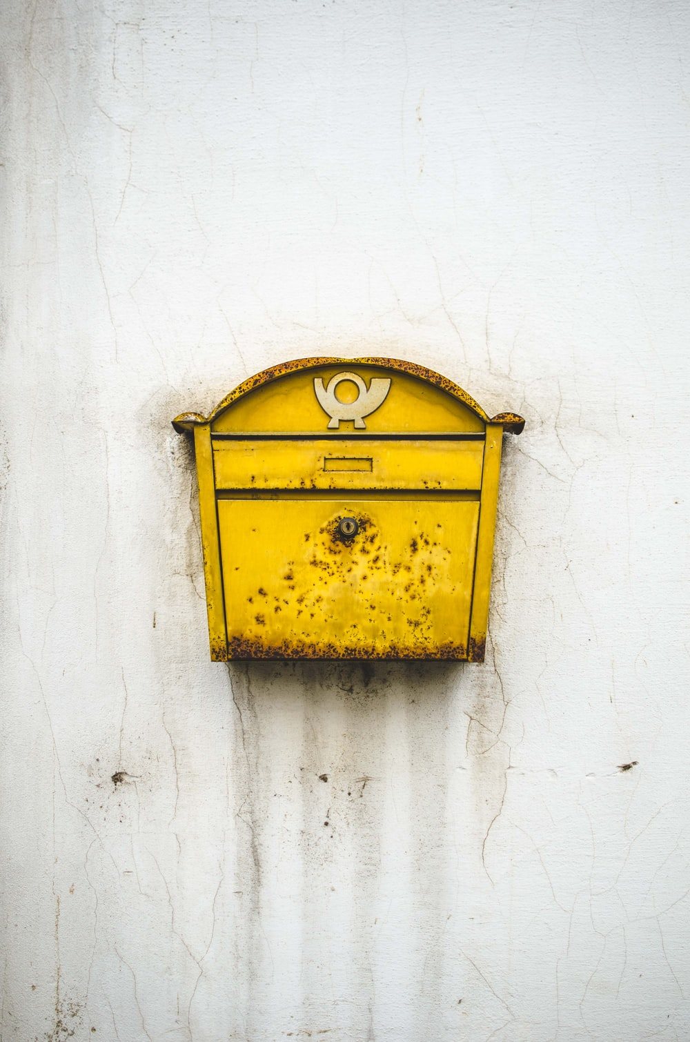 brass-colored mailbox