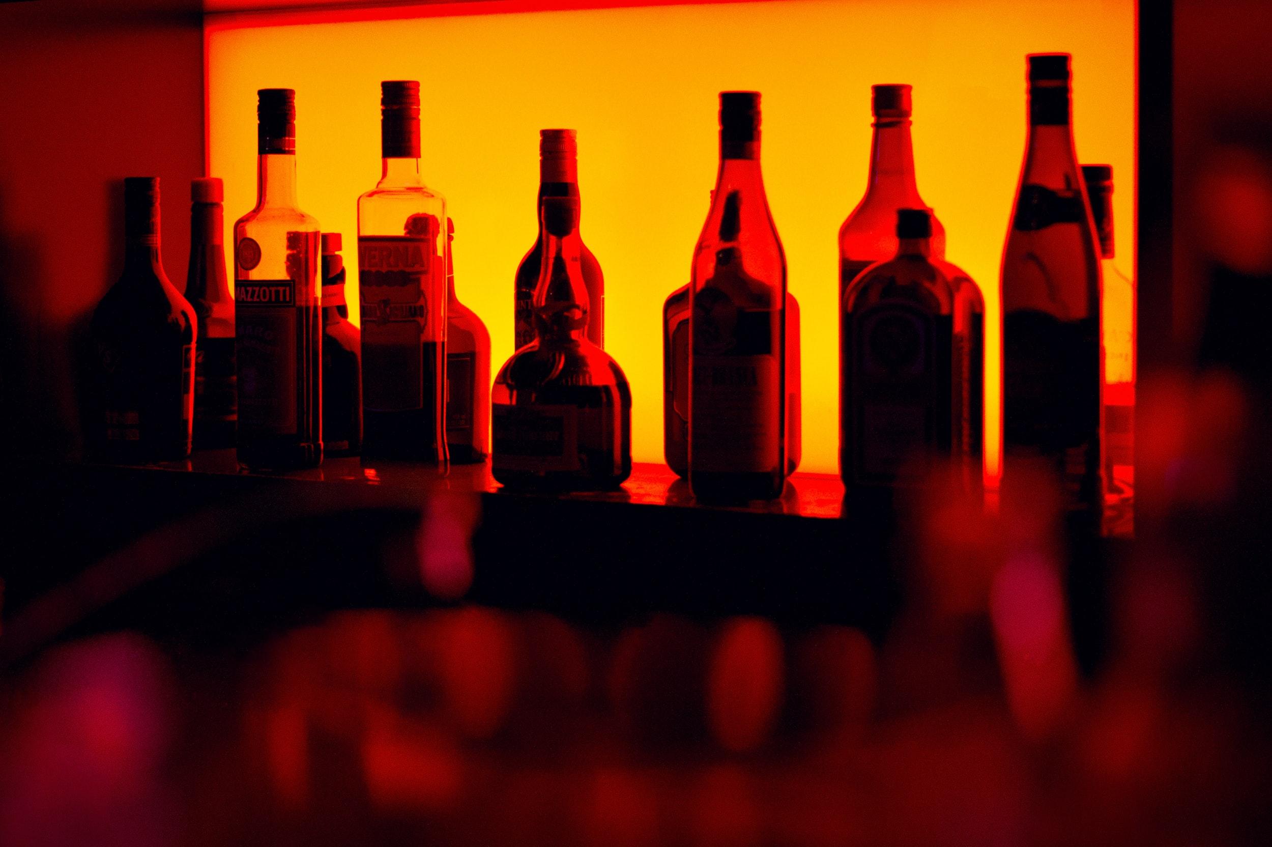 Gallery Image 16 - Liquor bottles in orange light