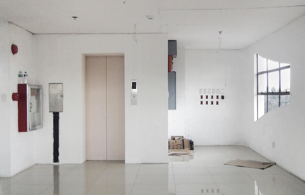 elevator door near firehose cabinet