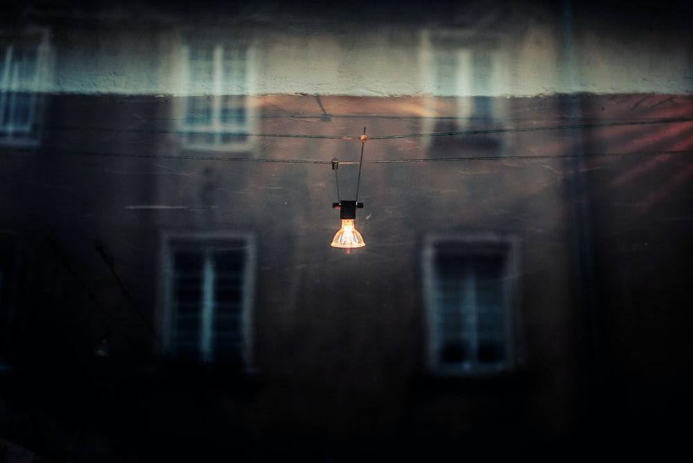 lighted lamp near building